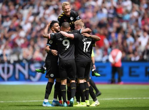 Manchester City players celebrate during their thumping 5-0 win over West Ham to start the season in style