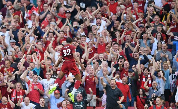 Joel Matip celebrates his goal against Arsenal.