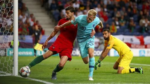 Van de Beek (right) fights for the ball in Netherlands' UEFA Nations final against Portugal