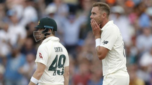 Stuart Broad celebrates the wicket of Tim Paine