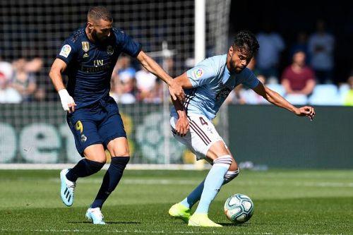 Karim Benzema (left) scored Real's first La Liga goal of the campaign during their 3-1 win over Celta Vigo