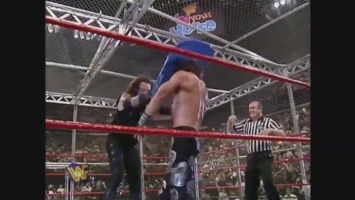 The Undertaker mashes HBK's noggin with a brutal chair shot.