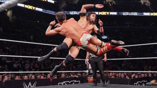 NXT stars Adam Cole and Johnny Gargano collide in mid-air during dual cross body attempts.