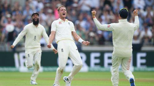 Stuart Broad celebrates taking the wicket of Steve Smith