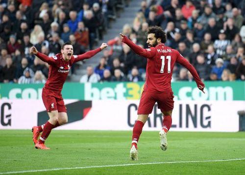 Mohamed Salah rejoices after scoring a Premier League goal for Liverpool