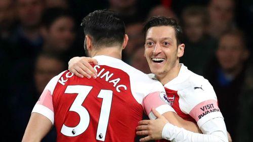 Sead Kolasinac and Mesut Ozil in action for Arsenal