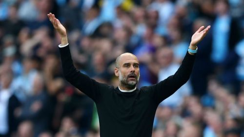 Pep Guardiola looks on as Manchester City's late winner is disallowed