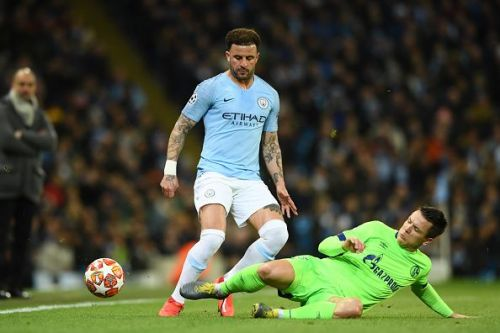 Manchester City's Kyle Walker (in blue).