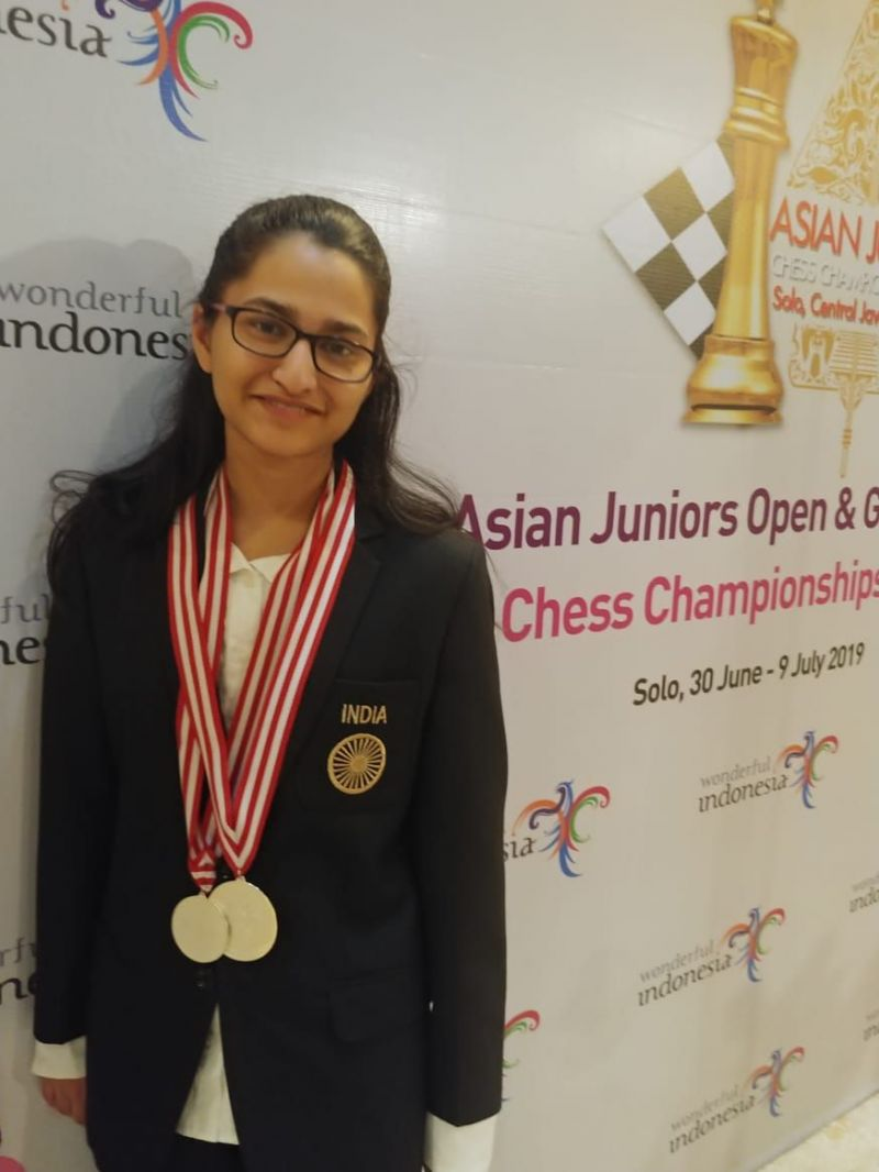 With my Asian Junior Medals. Source: Delhi Chess Association