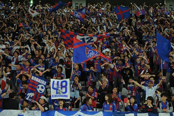 FC Tokyo fans cheer on their side