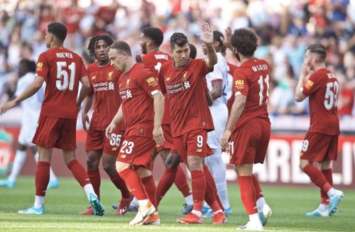 Firmino celebrates with Salah after his equaliser set the tone in Liverpool's final pre-season friendly of 2019