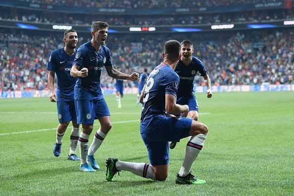 Chelsea players celebrate a goal against Liverpool