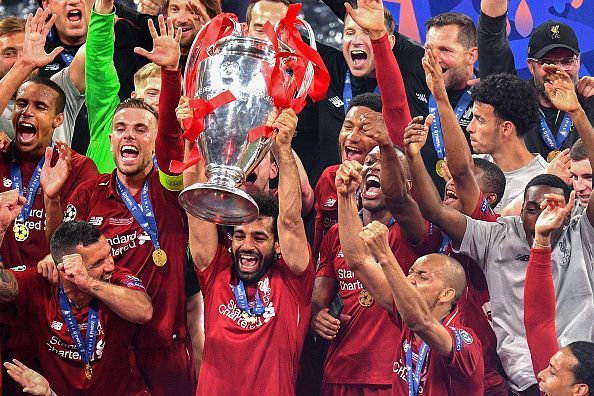 Salah celebrates with the Champions League trophy.