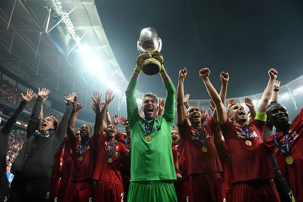 Adrian celebrates with the UEFA Super Cup trophy aloft after Liverpool