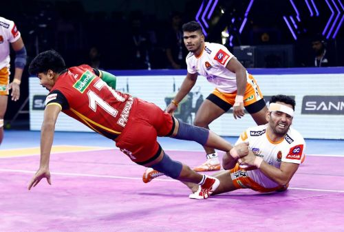 Surjeet Singh pulls off a successful ankle hold on Pawan Sehrawat