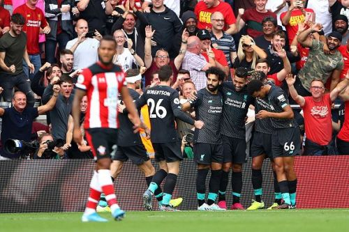Liverpool players celebrate Roberto Firmino's goal in a hard-fought 2-1 away win against Southampton