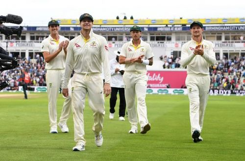 Smith leads Australia off the ground at the close of play