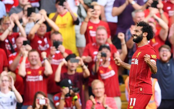 Mo Salah celebrates in front of the boisterous Anfield crowd.