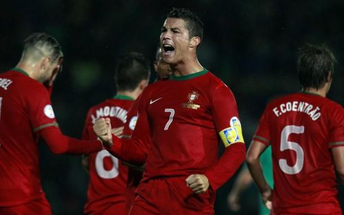 Cristiano Ronaldo rejoices after scoring one of his three goals in Belfast