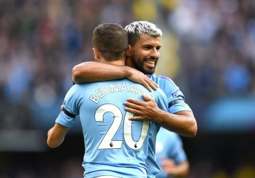 Manchester City's Sergio 'Kun' Aguero and Bernardo Silva celebrate