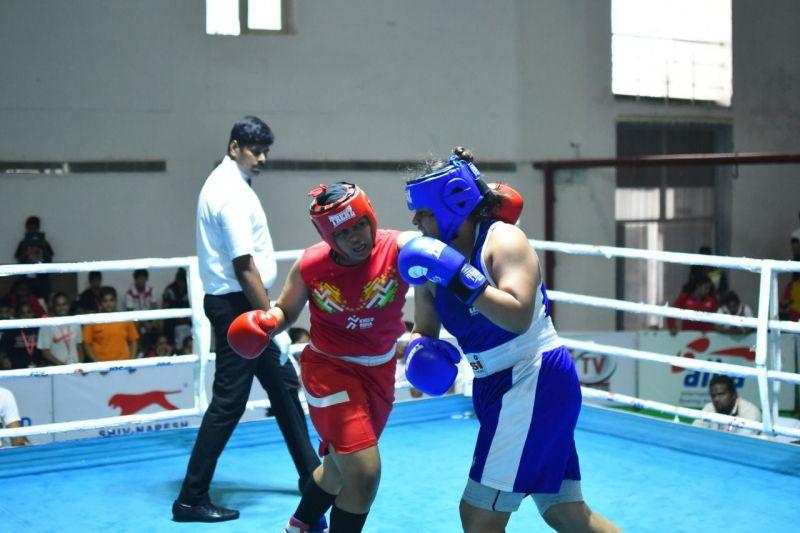 Junior women boxers in action