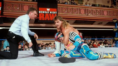 Shawn Michaels--resplendent in his 1990s mullet--puts the squeeze on Max Moon. Believe it or not, this is a match for the Intercontinental championship.