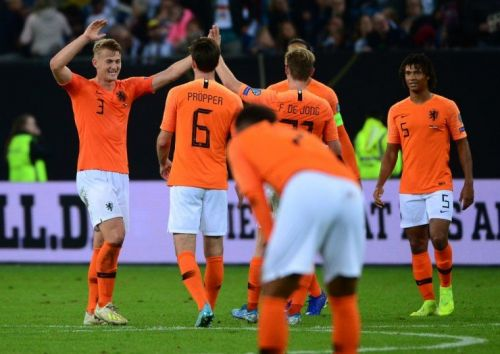 The Netherlands rejoice after their come-from-behind 4-2 win over Germany in Hamburg