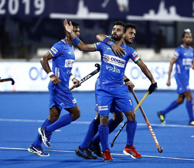 Manpreet Singh celebrates a goal