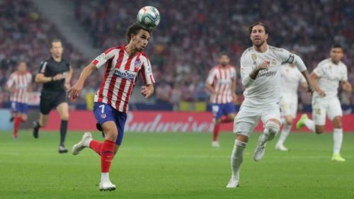 Atlético and Real in action in the first Madrid derby of the season.