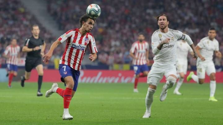 Atléticoand Real in action in the first Madrid derby of the season.