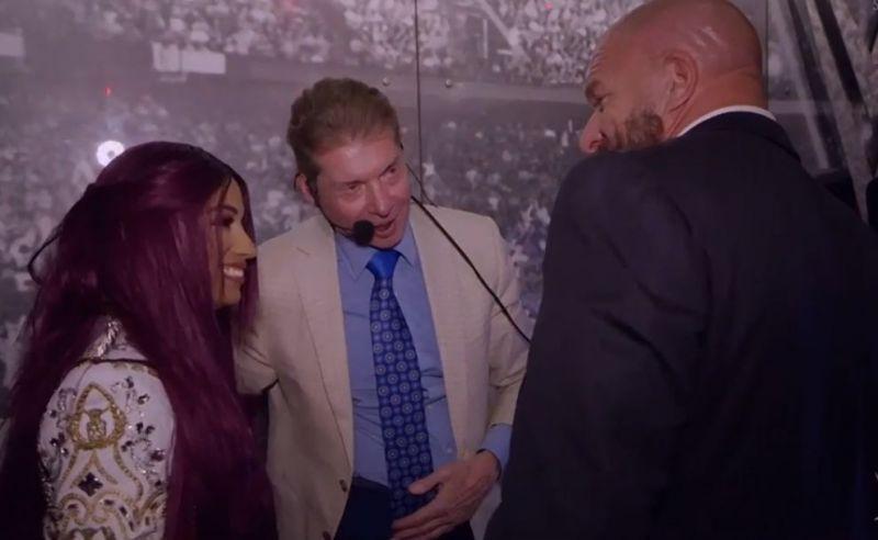 Sasha Banks with Vince McMahon and Triple H backstage