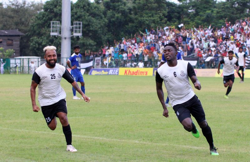 Mohammedan players celebrate a goal on Monday.