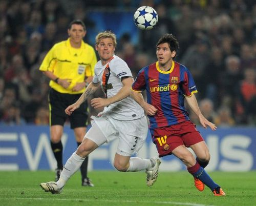 Messi in action in his debut Champions League game against Shakhar Donetsk in 2005-06