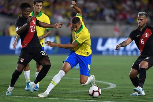 Brazil's Richarlison tries to breach the Peruvian defence