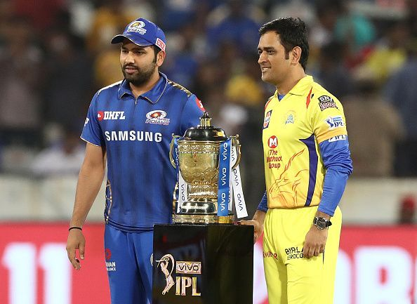 Rohit Sharma and MS Dhoni posing with the trophy before the 2019 IPL Final