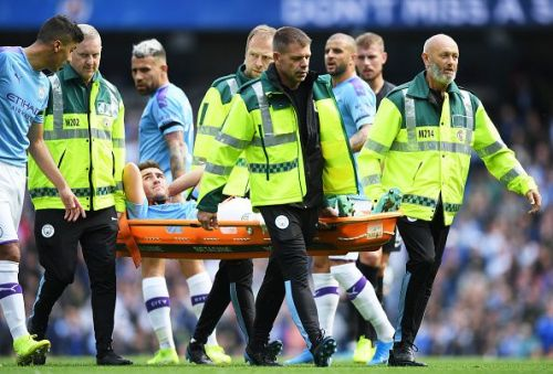 Manchester City's Aymeric Laporte being stretchered off
