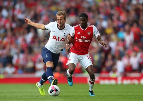 Ainsley Maitland Niles jostling with Harry Kane