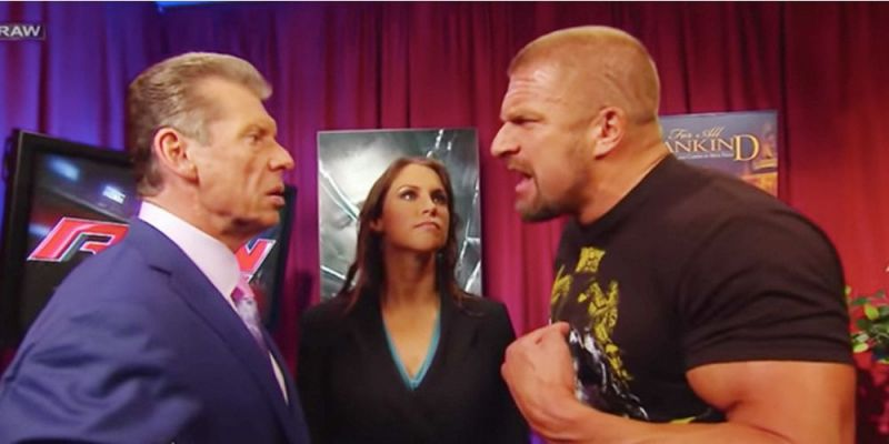 Vince McMahon and Triple H argue as Stephanie watches on
