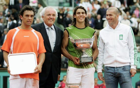 Nadal poses with his first French Open title in 2005