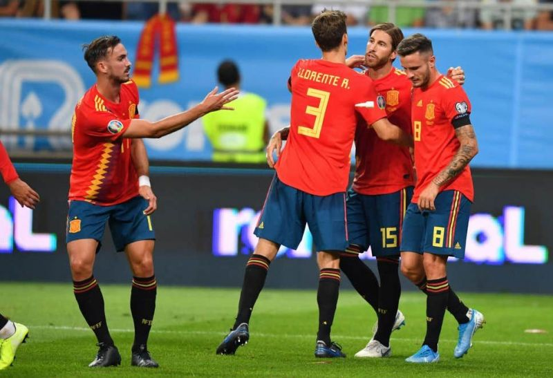 Spain players celebrate with captain Ramos after opening the scoring on the half-hour mark from the spot