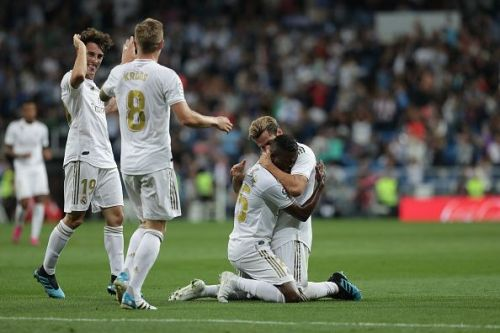 Real Madrid's players celebrate the opening goal