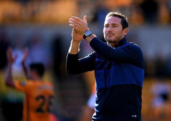 Frank Lampard applauds the travelling fans