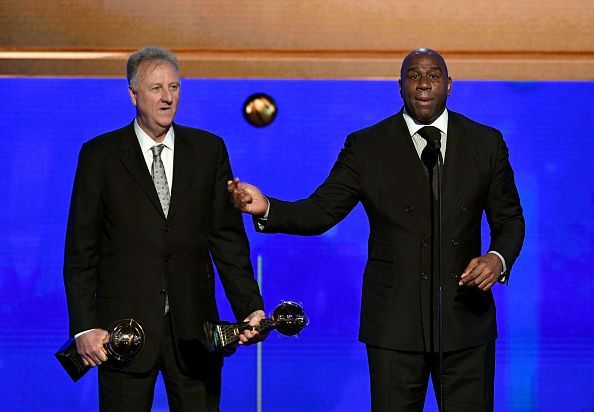 Magic Johnson (right)