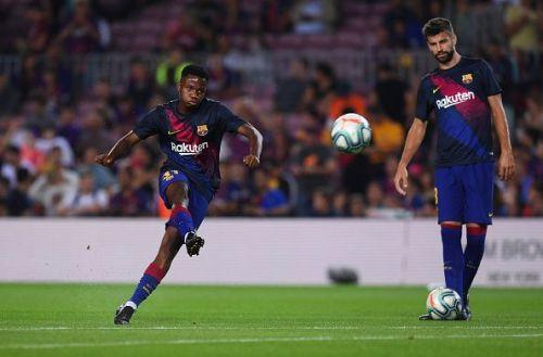 FC Barcelona's Ansu Fati (L) and Gerard Pique (R)