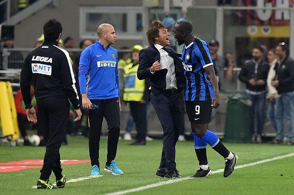 Romelu Lukaku (far right) celebrates with his manager, Antonio Conte