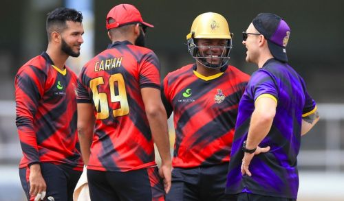 Brendon Mccullum, Head Coach, Trinbago Knight Riders in discussion with Brian Lara and other players.