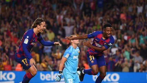 Young Ansu Fati celebrates his goal against Valencia