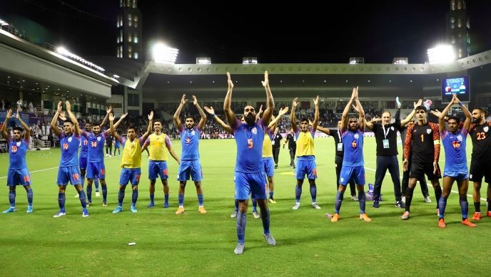 Team India celebrate before the away crowd