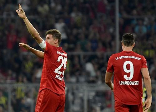 Bayern Muenchen's Thomas Muller and Robert Lewandowski