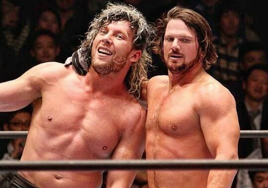Kenny Omega (left) with AJ Styles (right)